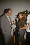 Thomas Demand and  Miuccia Prada, EXHIBITION OF WORK BY THOMAS DEMAND ( SUPPORTED BY WALLPAPER) AT THE SERPENTINE GALLERY AND AFTERWARDS AT THE Rochelle Canteen, Rochelle School<br />Arnold Circus. London E2. 5 JUNE 2006. ONE TIME USE ONLY - DO NOT ARCHIVE  © Copyright Photograph by Dafydd Jones 66 Stockwell Park Rd. London SW9 0DA Tel 020 7733 0108 www.dafjones.com