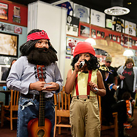 Sisters Josselyn Benally, 9, dressed as Chong and Jazmin Benally, 6, dressed as Cheech participate in a costume contest at Sammy C's Rockin Sports Pub & Grille on Halloween.