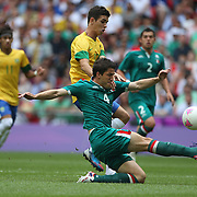 Hiram Mier, Mexico, clears while challenged from Oscar, Brazil,  during the Brazil V Mexico Gold Medal Men's Football match at Wembley Stadium during the London 2012 Olympic games. London, UK. 11th August 2012. Photo Tim Clayton