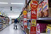 A red price cut sign in the cereal section highlights discounted products in British supermarket chain Morrisons on 23rd August, 2021 in Leeds, United Kingdom. British supermarket chain Morrisons, which employs over 110,000 staff across its 500 shops, has accepted a £6.3bn $8.7bn takeover bid from US private equity firm Fortress Investment Group.