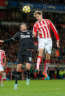Peter Crouch of Stoke competes with Lukas Jutkiewicz of Burnley (left) - Football - Barclays Premier League - Stoke City vs Burnley - Britannia Stadium Stoke - Season 2014/2015 - 22nd November 2015 - Photo Malcolm Couzens /Sportimage