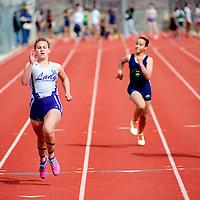 033013       Adron Gardner<br /> <br /> Miyamura Patriot Cara DePauli, left, leads her 100m dash heat during the Gallup Invitational at Public School Stadium Saturday.