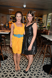 Left to right, dancer KATYA VIRSHILAS and BENEDETTA GHIONE at Henry Conway's 31st birthday party held at the Pont St Restaurant, Belgraves Hotel, London on 12th July 2014.