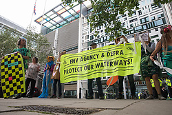 London, UK. 5th August. 2021. Extinction Rebellion activists protest outside the Department for Environment, Food and Rural Affairs (Defra) against the pollution of the UK's waterways. The activists were highlighting pollution of rivers by water companies and farms and the failure of the Environment Agency and Defra to protect waterways and to prosecute offenders.