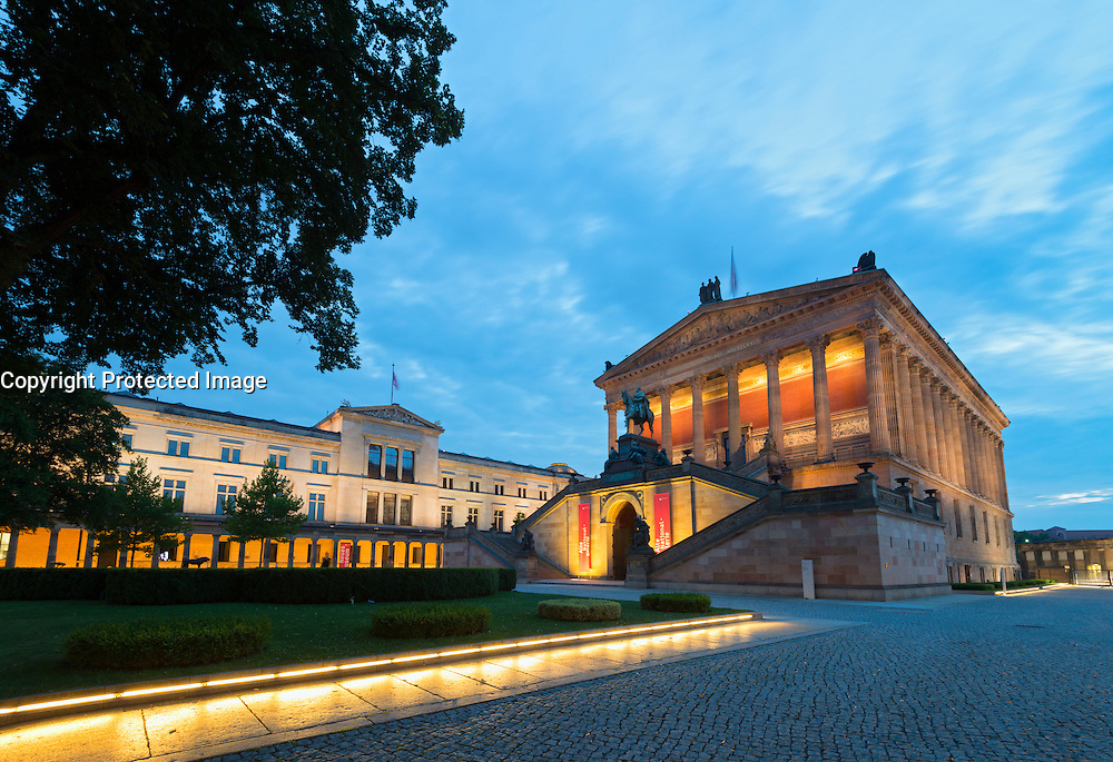 Evening view of Neues Museum on left and Alte Nationalgalerie on Museumsinsel or Museum Island in Berlin Germany