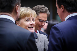 Angela Merkel, Germany's chancellor, center, speaks with David Cameron, the U.K.'s prime minister, right, during the first day of the EU Summit, at the European Council headquarters in Brussels, Belgium on Thursday, Dec. 13, 2012. (Photo © Jock Fistick)