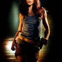 Sexy Laura Croft style woman adventurer with Broom Handle Mousser pistol.