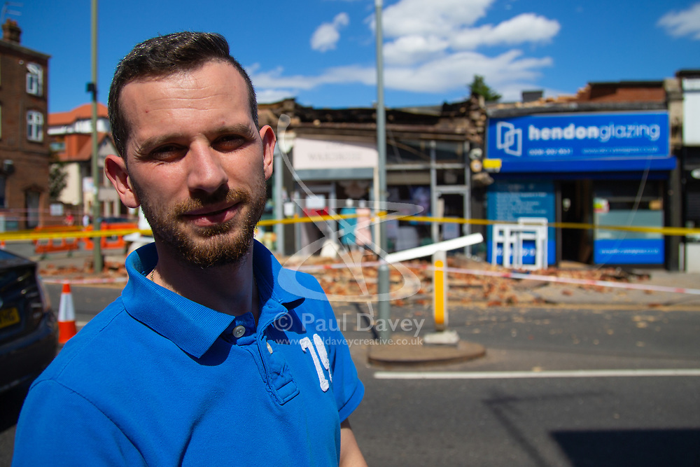 """PICTURED: Lucian Filote. A facade on a row of shops on Brent Street in Hendon has collapsed, causing police to close off the road whilst they make the site safe. No injuries were reported. According to the manager of the Hendon Glazing, Lucian Filote, 30, """"We were working in the shop as usual when we heard a loud bang. At first we thought it was a crash on the road but as we approached the shop entrance we saw the pile of rubble outside. Our first concern was that someone might have been hit by the falling bricks. We went and looked in the rubble but there was no one. We were concerned for our safety as there was a reinforcing bar with a lump of concrete hanging from it."""" . Hendon, London, June 18 2018."""