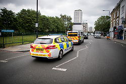 © Licensed to London News Pictures. 10/06/2021. London, UK. Police cars drive through the scene on Stockwell Road in south London were a woman was hit and killed by a police car yesterday evening. Photo credit: Ben Cawthra/LNP