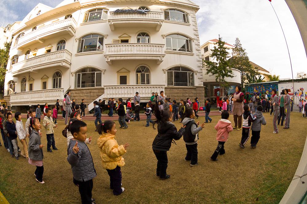 Children exercising before school at the Tongyuan Art Kindergarten, Suzhou, China