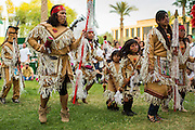 23 APRIL 2012 - PHOENIX, AZ:   An Apache Indian dance troupe performs a blessing dance at the Arizona State Capitol Monday. About 200 high school students from across the Phoenix metropolitan area rallied at the Arizona state capitol in Phoenix Monday to show their opposition to Arizona's tough anti-immigration law, SB 1070. April 23 is the 2nd anniversary of the law's signing. The US Supreme Court is taking up the law during a hearing Wednesday, April 25 in Washington DC.        PHOTO BY JACK KURTZ