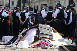 © Licensed to London News Pictures. 19/04/2019. London, UK. A large amount of rubbish has been gathered in Oxford Circus as the police prepare to remove the environmental activist on the fifth day of the climate change protest by the Extinction Rebellion movement group. According to the Met Police, over 700 activists have been detained over the last five days.  Photo credit: Dinendra Haria/LNP