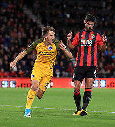 Brighton & Hove Albion's Solly March (left) celebrates scoring his side's first goal of the game during the Premier League match at the Vitality Stadium, Bournemouth.