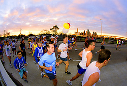 Stock photo of Houston marathon participants starting early at sunrise