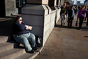 Woman sits eating fast food from a bag. Fast (or junk) foods while being very high in calories are not directly responsible fro obesity levels, although studies show that having a diet with high consumption of these food items is more likely to make you overweight.