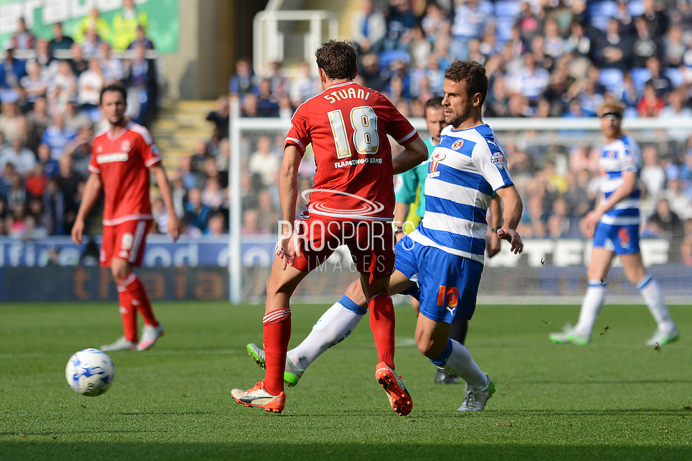 Reading striker Orlando Sa plays the ball past Middlesbrough striker Christian Stuani during the Sky Bet Championship match between Reading and Middlesbrough at the Madejski Stadium, Reading, England on 3 October 2015. Photo by Alan Franklin.