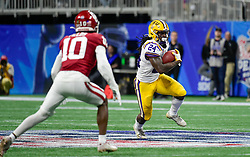 LSU Tigers running back Chris Curry (24) carries the ball during the first half against Oklahoma Sooners in the 2019 College Football Playoff Semifinal at the Chick-fil-A Peach Bowl on Saturday, Dec. 28, in Atlanta. (Vasha Hunt via Abell Images for the Chick-fil-A Peach Bowl)