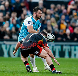 Scott Baldwin of Ospreys under pressure from Ryan Bevington of Dragons<br /> <br /> Photographer Simon King/Replay Images<br /> <br /> Guinness PRO14 Round 12 - Dragons v Ospreys - Sunday 30th December 2018 - Rodney Parade - Newport<br /> <br /> World Copyright © Replay Images . All rights reserved. info@replayimages.co.uk - http://replayimages.co.uk