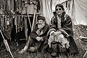 Sepia photographs of a mountain men rendezvous held at Camp Henry, ID. Trappers and traders assemble  at the historic camp site each June.