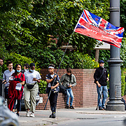 A protestor is seen waving a British bloodied flag during a protest in front of the US Embassy in East London on Saturday, July 11, 2020 - during a protest organised by the Black Lives Matter movement against systematic racial injustice. Anger against systemic levels of institutional racism have raged through the city, and worldwide; sparked by the death of George Floyd who died on May 25 after he was restrained by Minneapolis police in the United States. (VXP Photo/ Vudi Xhymshiti)