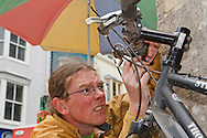 Reuben mending a frayed cable on the Thorn bike during the Welsh Coast cycle tour - running repairs are part of a long cycle tour