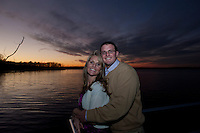 Engagement couple Ashley and Ryan are photographed at sunset at the Manasquan Reservoir. / Photo by Russ DeSantis Photography and Video, LLC