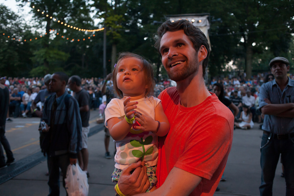 A man and his daughter watch and listen to Banda Magda at Celebrate Boroklyn!