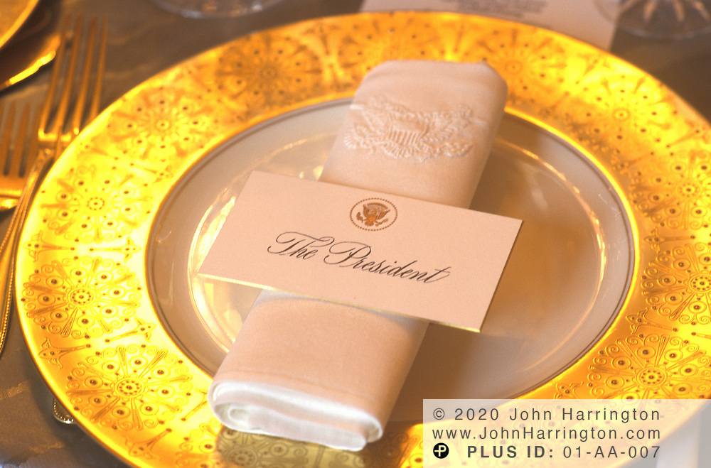 THE PRESIDENT'S PLACE SETTING PREPARED FOR A STATE DINNER.