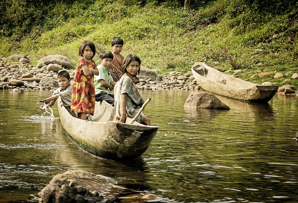 Children in dugout canoes.