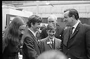 Aer Lingus Young Scientist of the Year..1971..08.01.1971..01.08.1971..8th January 1971..The annual Aer Lingus Young Scientist of the year was held in The R.D.S.Dublin.Once again, this year,there was an outstanding display of projects by school children from around the country,many of which,it is hoped,will have applications into the future. The main speaker at the event was Mr Patrick Faulkner TD, Minister for Education..Image of the Minister congratulating Peter J Shortt,(centre) overall winner of the Young Scientist Award,from Presentation College,Clane and both runners up, Joyce Greene,Holy Trinity College, Cork and Peter Duggan,Gonzaga College,Dublin.