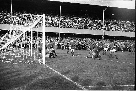 Waterford FC vs Manchester United at Lansdowne Road..1968..18.09.1968..09.18.1968..18th September 1968..Waterford FC as champions of the league of Ireland drew Manchester United, the European Champions,in the first round of this years competition.The Waterford team was as follows: Peter Thomas, Peter Bryan, Noel Griffin, Vinny Maguire, Jackie Morley, Jimmy McGeough, Al Casey, Alfie Hale, John O'Neill, Shamie Coad and Johnny Matthews. Manchester United won the tie 3 -1 with Denis Law being the man of the match..Alex Stepney,Tony Dunne,Francis Burns,Paddy Crerand,.Bill Foulkes,Nobby Stiles,George Best,Denis Law,.Bobby Charlton,David Sadler,Brian Kidd were the starting eleven for United...Image shows a goal mouth scramble as United apply pressure on the Waterford goal.