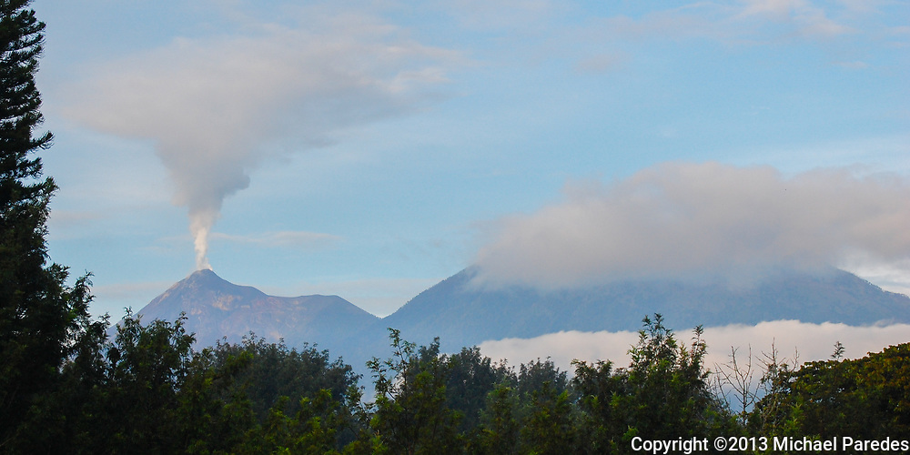 """The volcano named """"Fuego"""" , or """"smoke"""" can be counted most days in Antigua, Guatemala"""