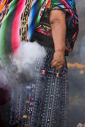 Mayan woman swinging incense in front of Santo Tomás Chichicastenango (church), Chichicastenango, Guatemala