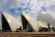 Tourists take photographs outsideSydney Opera House, Australia