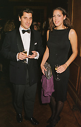MR DIMITRI GOULANDRIS and MISS JESSICA DE ROTHSCHILD, at a party in London on 22nd February 1999.MON 154