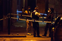 © Licensed to London News Pictures.25/01/2021, London,UK. Police guard a crime scen after a fatal stabbing in Islington north London. At approximately 5:30pm police were called to a report of stabbing. Despite the effort of medics a teenage was pronounced dead at the scene. One male has been arrested. Photo credit: Marcin Nowak/LNP