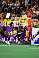 4/12/2007 - Dustin Almond of the Frisco Thunder tries to avoid the defense of the Alaska Wild as he tries to jump the wall in the first professional football game in the State of Alaska against the home team Alaska Wild.  The Thunder scored 46 against the Wild 33 points in this landmark game.