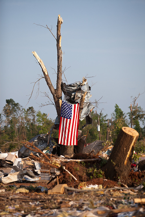 An American Flag on hung on a broken tree in Holt Alabama in an area destroyed by a tornado. Holt, a suburb of Tuscaloosa remains in a state of ruin over two weeks after it was hit by an F-4 ( possibly an F-5) tornado, one of an estimated 300 that struck Alabama and the neighboring states on April 27th , 2011. suburb of Tuscaloosa remains in a state of ruin over two weeks after it was hit by an F-4 ( possibly an F-5) tornado, one of an estimated 300 that struck Alabama and the neighboring states on April 27th , 2011.