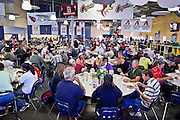 """Sept. 27 - PHOENIX, AZ: Lunch at the Society of St. Vincent de Paul in Phoenix, Monday, Sept 27. September 27, 2010 is the 350th Feast Day of Saint Vincent de Paul, also known as the """"Apostle of Charity."""" To mark the day, the Society of St. Vincent de Paul in Phoenix served birthday cake during the lunch service. The US Census office recently announced that poverty in the US has spiked to 14.3% of the population, the highest poverty rate since 1994. Officials at St. Vincent de Paul in Phoenix said that demand for their services have increased steadily in the last three years. They currently feed about 1,100 people, either homeless or members of the working poor, every day.    Photo by Jack Kurtz"""