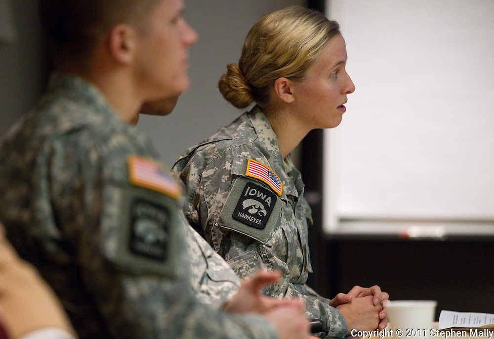 University of Iowa ROTC Color Guard member Trudie Gabaldo (right) listens to the speakers at the University of Iowa Veterans Reception at the Old Capitol Mall in Iowa City on Wednesday evening, November 9, 2011. (Stephen Mally/Freelance)