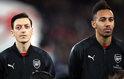 Arsenal's Mesut Ozil (left) and Pierre-Emerick Aubameyang prior to kick-off during the UEFA Europa League round of 32 second leg match at the Emirates Stadium, London.