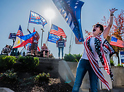 Trump supporters gather and wave flags at the intersection of Cirby Way and Sunrise Avenue in Roseville, California on Election Day on Tuesday, Nov. 3, 2020.