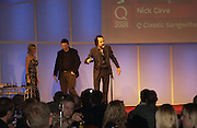 Ian Rankin and Nick Cave.  The Q Awards, the  magazine's annual music awards,  Grosvenor House. October 10 2005. ONE TIME USE ONLY - DO NOT ARCHIVE © Copyright Photograph by Dafydd Jones 66 Stockwell Park Rd. London SW9 0DA Tel 020 7733 0108 www.dafjones.com