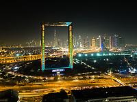 Aerial view of the illuminated Dubai Frame at night, U.A.E.
