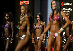 Sept.16, 2016 - Las Vegas, Nevada, U.S. -  Women awaiting their turn on center stage view their competitors in the Bikini Olympia contest during Joe Weider's Olympia Fitness and Performance Weekend.(Credit Image: © Brian Cahn via ZUMA Wire)