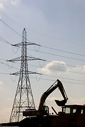 Olympic park. Electricity pylon and digger. Picture by Anthony Charlton.