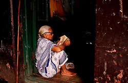 November 9, 2016 - Bhubaneswar, Orissa, India - Widows look inside a Dharmasala (rest house for pilgrims) for rituals in the holy month √¢'ǨÀúKartik√¢'Ǩ'Ñ¢ on the start day of five days long √¢'ǨÀúPanchuka√¢'Ǩ'Ñ¢ festival at in Bhubaneswar on Wednesday, 09 November 2016. Widows shelter guest houses near to temple as they stay together for the rituals in this festival in every year and end their rituals after sail fancy boats in nearby water bodies along with flower, coin and earthen lamps. (Credit Image: © Str/NurPhoto via ZUMA Press)