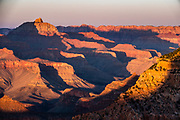 Sunset at Mather Point Overlook, Grand Canyon National Park, Arizona, USA. Starting at least 5 to 17 million years ago, erosion by the Colorado River has exposed a column of distinctive rock layers, which date back nearly two billion years at the base of Grand Canyon. While the Colorado Plateau was uplifted by tectonic forces, the Colorado River and tributaries carved Grand Canyon over a mile deep (6000 feet), 277 miles  long and up to 18 miles wide.