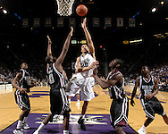 Kansas State University -- Kansas State Wildcats forward Michael Beasley (30) puts up a shot between Texas A&M Aggies defenders Bryan Davis (0) and Derrick Roland (3) in the first half of the Wildcats 75-54 win over the Aggies at Bramlage Coliseum in Manhattan, KS.