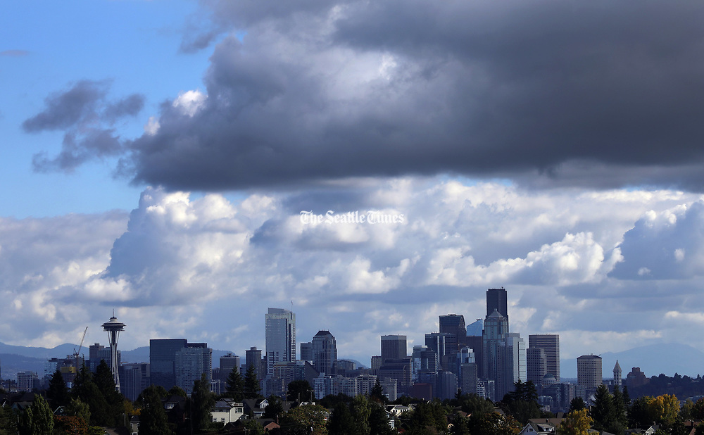 Seattle saw plenty of clouds, some even looking a little rainy, but things stayed dry and sunny. (Ken Lambert / The Seattle Times)